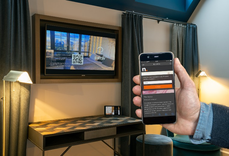 SuiteCast being used in a hotel room with hotel room tablets