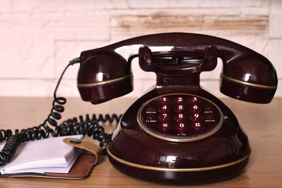 Canva - Maroon Push Button Telephone on Table
