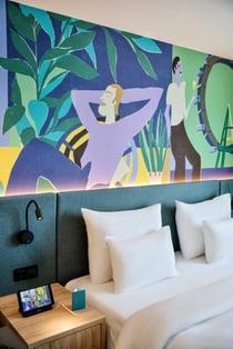 SuitePad Tablet im Schlafzimmer im BASSENA Hotel Wien
