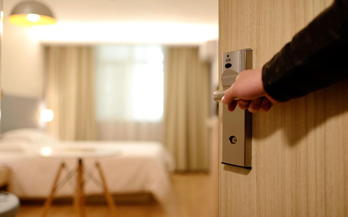 Person entering hotel room